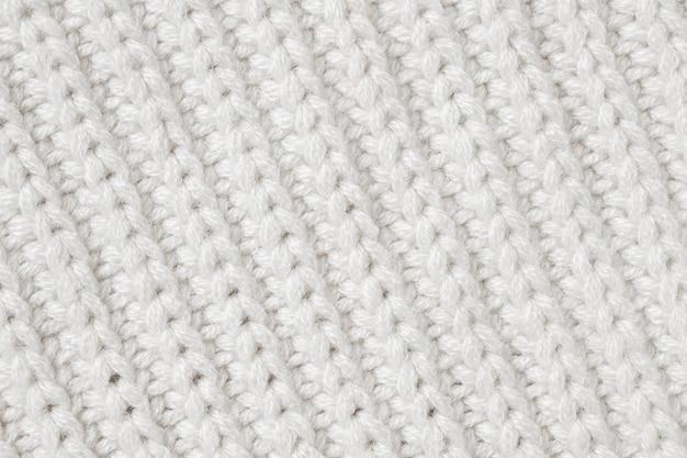 Witte gebreide wollen stof textuur achtergrond