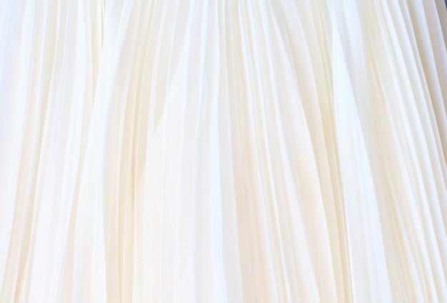 Witte geplooide stof