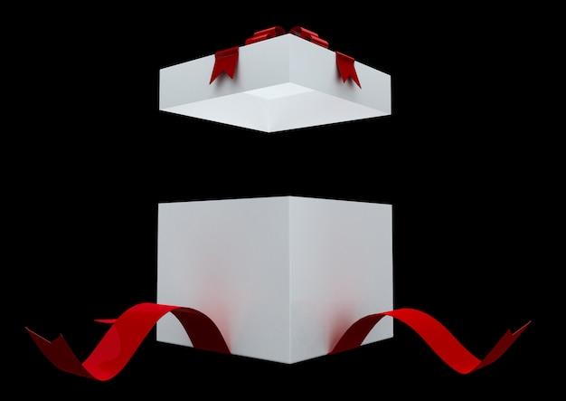 Witte geschenkdoos met rode boog en confetti geïsoleerd op zwarte achtergrond. verrassing geschenkdoos.