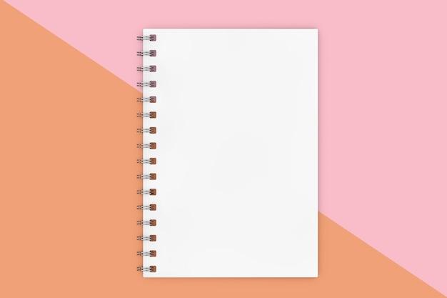 Witte gesloten spiraalvormige papieren omslag mockup notebook op een roze diagonale achtergrond. 3d-rendering
