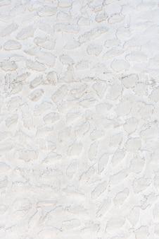 Witte gevormde steenachtergrond