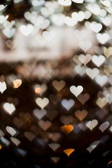 Witte hartvormige lichtenachtergrond