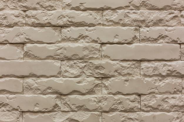 Witte horizontale de textuurachtergrond van de gebroken steenbakstenen muur