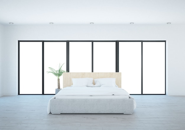 Witte kamer met bedkussens en brede ramen