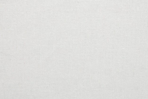 Witte katoenen de textuurachtergrond van de stoffendoek