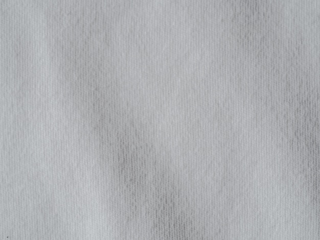 Witte katoenen stoffentextuur. kleding katoenen jersey achtergrond met vouwen