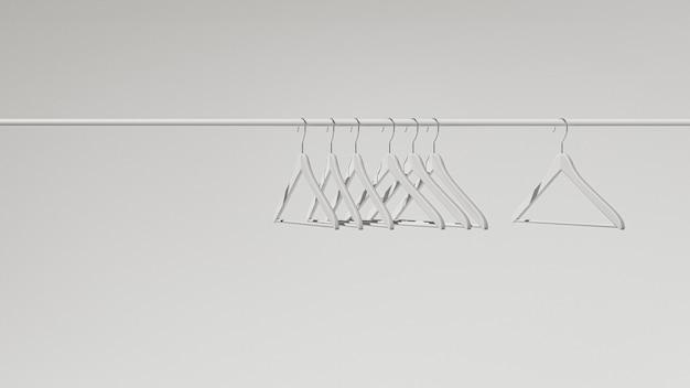 Witte kleerhangers aan een rail. minimalistisch verkoopontwerp. 3d-illustraties