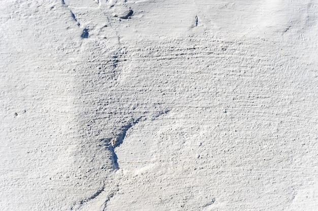 Witte kleipleister op de muur. textuur en achtergrond.