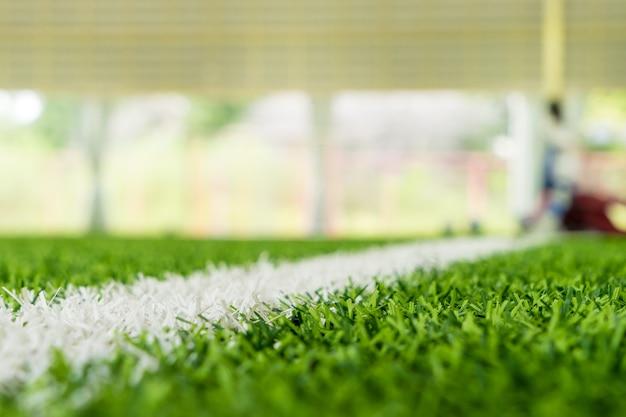 Witte lijn op de rand van een indoor voetbal sportveld