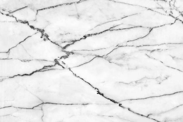 Witte marmeren vloeren, natuurlijk patroon voor prachtige achtergronden. geschikt voor gebruik op een luxe achtergrond.