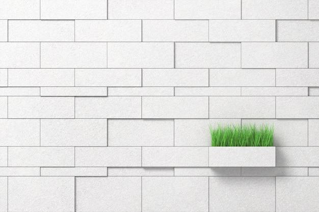 Witte muur van blokken van verschillende grootte met een pot groen