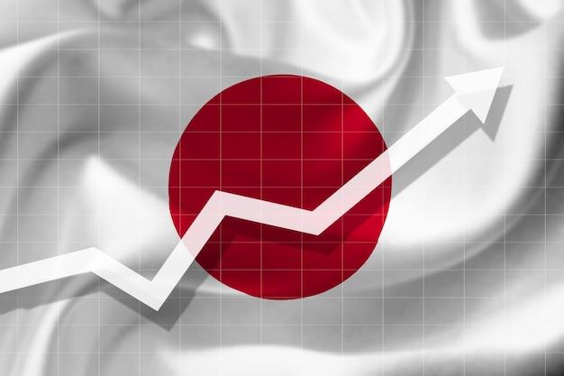 Witte pijlgroei omhoog op de achtergrond van de vlag van japan