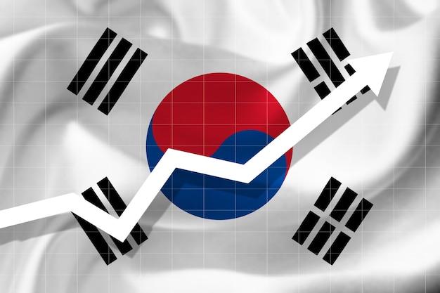 Witte pijlgroei omhoog op de achtergrond van de vlag van zuid-korea