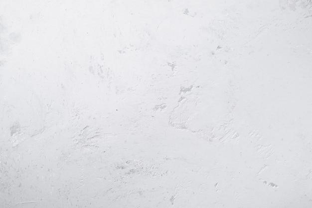 Witte pure betonnen wand met natuurlijke textuur, muur of vloer achtergrond