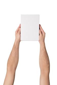 Witte rechthoekige doos in mannelijke handen