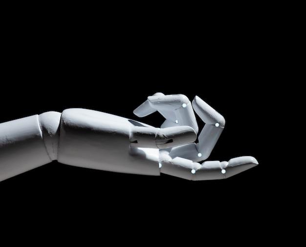 Witte robot hand vinger punt geïsoleerd op zwarte achtergrond