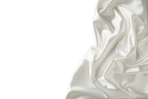 Witte satijnen stof geïsoleerd op een witte achtergrond.