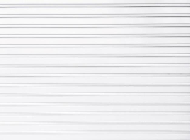 Witte schuifdeurachtergrond, roldeur, schuifdeur met metalen plaat