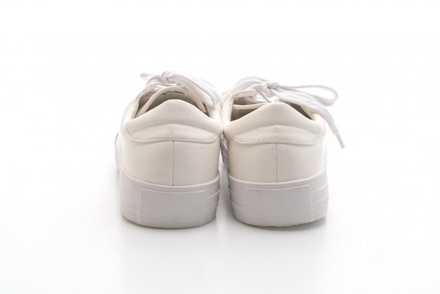 Witte sneakers geïsoleerd