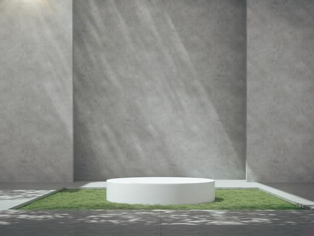 Witte sokkels voor productshow in betonnen ruimte met grasveld.