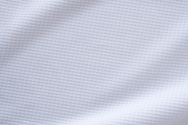 Witte sportkleding stof voetbalshirt jersey textuur abstracte achtergrond