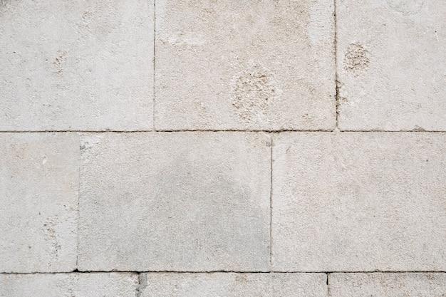 Witte stenen muur achtergrond
