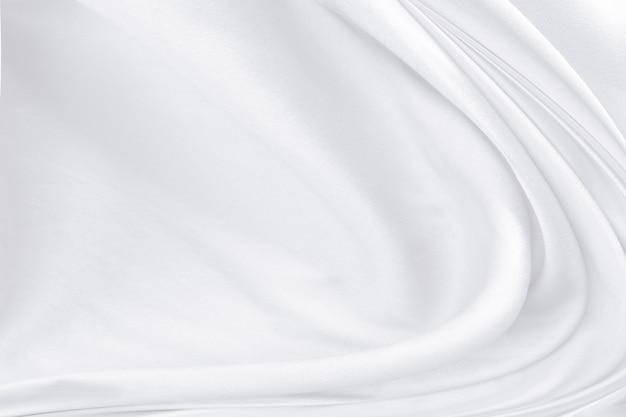 Witte stof textuur achtergrond, golvende stof