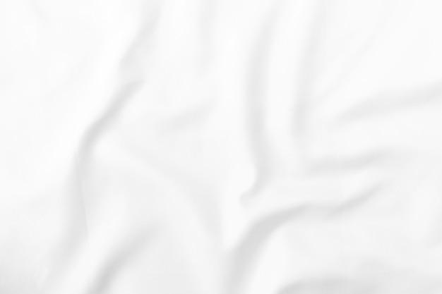 Witte stoffentextuur. voor het patroon in advertentieontwerp of als achtergrondafbeelding.