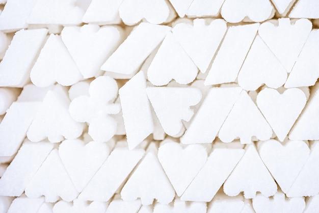 Witte suikerachtergrond, vorm van het symbool van het speelkaartkostuum