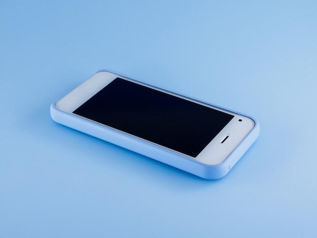 Witte telefoon in blauwe behuizing