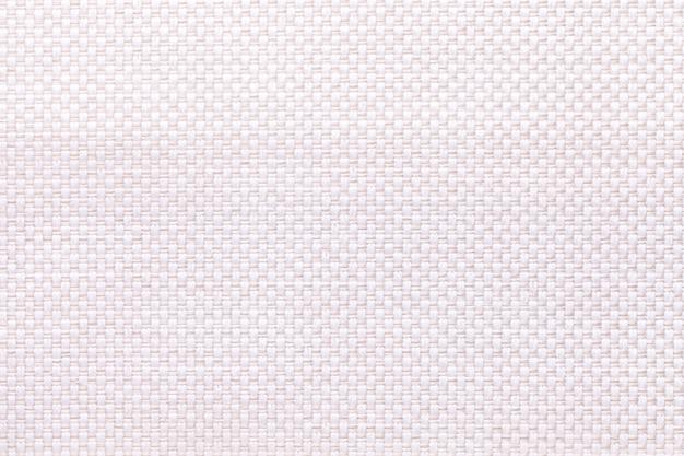 Witte textielclose-up als achtergrond. structuur van de stoffenmacro