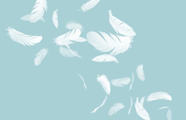 Witte veren zwevend in de lucht op blauwe pastel achtergrond