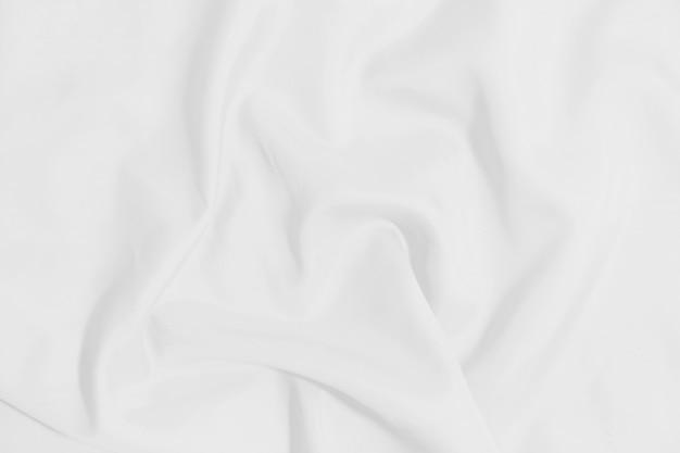 Witte verfrommelde algemene textuurachtergrond. witte doek achtergrond