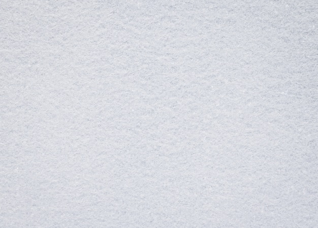 Witte vilten textuur. lege stoffenachtergrond. detail van tapijtmateriaal.