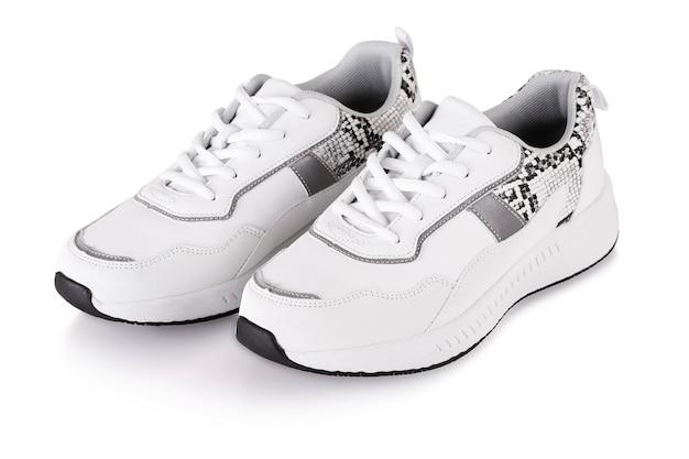 Witte vrouwen sneakers geïsoleerd op witte backround