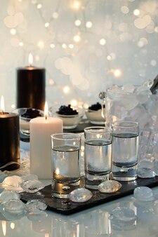 Wodka, zwarte kaviaar en canddlesbuffet