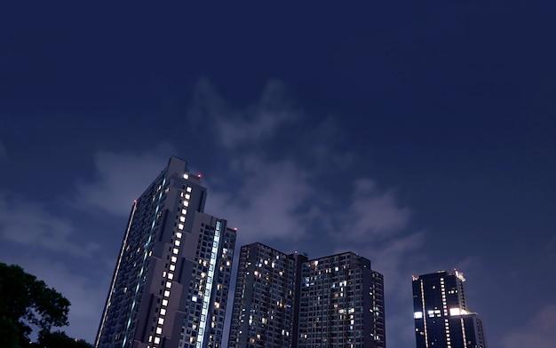 Wolkenkrabbers 's nachts met donkerblauwe lucht op de achtergrond