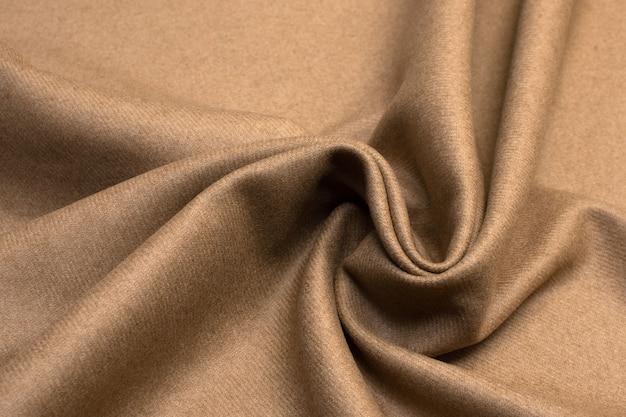 Wollen stof beige textuur achtergrondkleur