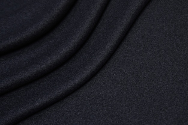 Wollen stof in grijze close-up textuur