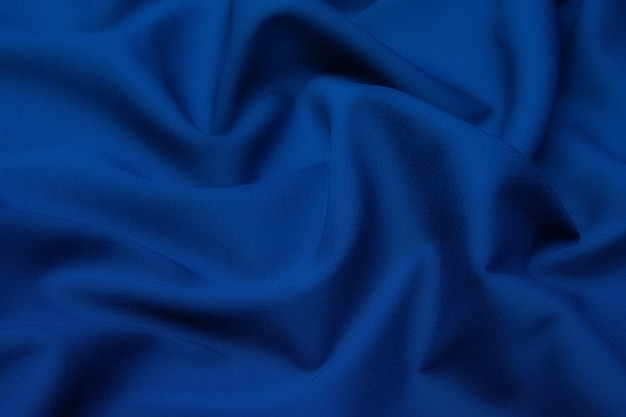 Wollen stof. kleur zwart en blauw. textuur, achtergrond, patroon.