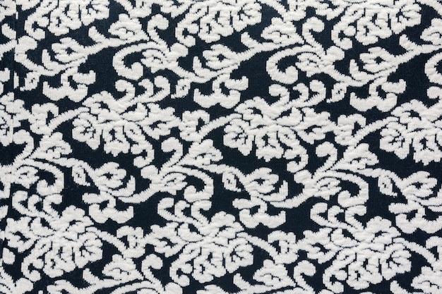 Wollen stof met een abstract patroon in zwart en wit als natuurlijke achtergrond
