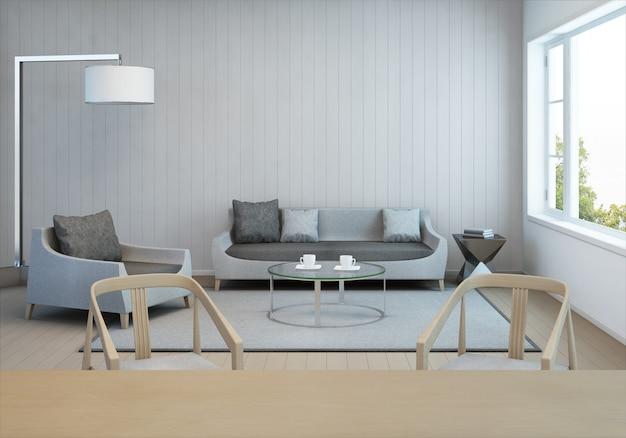 Woonkamer en eetkamer in modern huis met witte houten muur.