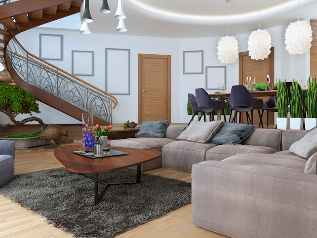 Woonkamer met een grote hoekbank van een stof in een eigentijdse stijl met wenteltrap naar de tweede verdieping.