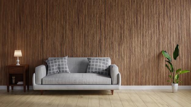 Woonkamer met een houten wand en een grijze bank
