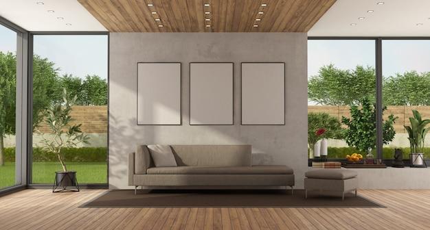 Woonkamer met groot raam en moderne bank op betonnen muur