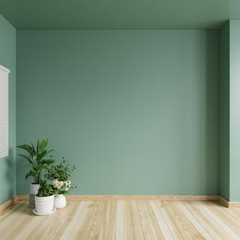 Woonkamer met lege groene muur en plantenpotten op de vloer