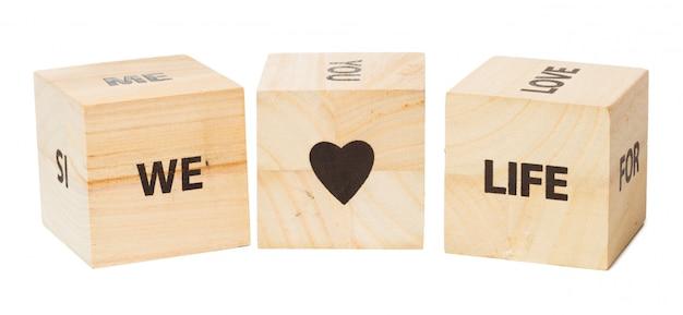Woord geschreven in houten kubus