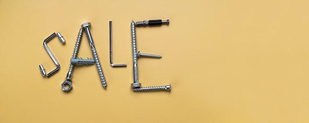 Woorden verkoop, frame met kopie ruimte gemaakt van bouten