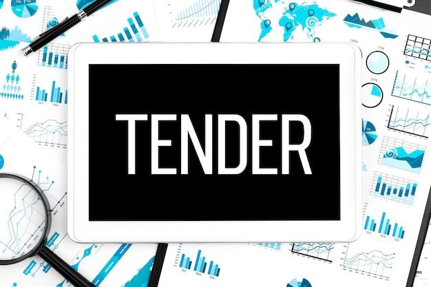 Word tender op tablet, klembord, vergrootglas, grafiek, diagram en pen op bureau. bedrijfsconcept.