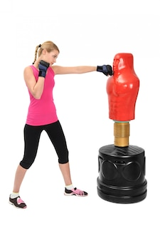 Young boxing lady met body opponent bag mannequin